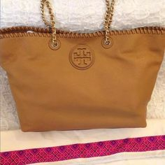 """Tory Burch MARION Tote in Tan New With Tag- Tory Burch-Medium Chain Tote; Hardware: Gold Closure: Open with Magnetic Snaps Lining: Jacquard Lining Handle: Chain Leather Double Straps Size: Medium Color: Tan  Material: Pebbled Leather  Measurements:19""""H x 4""""D x 12""""L; Strap Drop 11"""" Features  1 Main Open Enclosure with Magnetic Snaps Exterior Leather Raised Tory Burch Logo Pebbled Leather Gold Tone Hardware Whipstitching finish 1 Interior Zip Pocket 2 x Interior Open Pockets Tory Burch Bags…"""