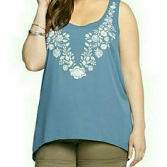 Embroidered sharkbite torrid top size 0 Blue lightweight top with white floral embroidery. Flowy cut torrid Tops Tank Tops