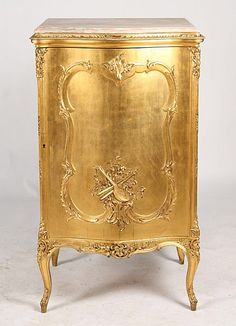 19TH C./ Marble top FRENCH GILTWOOD MUSIC CABINET, serpentine front door w/ carved instrument motif