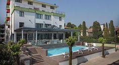 Hotel San Marco Peschiera del Garda Set right on the shores of Lake Garda, Hotel San Marco is 500 metres from the historic centre of Peschiera del Garda. It features a summer swimming pool and is just a few kilometres from the area's theme parks and golf courses.