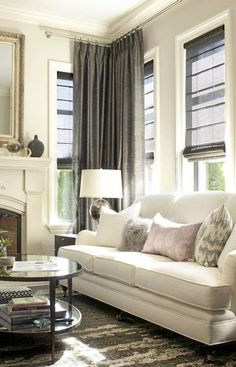Gray curtains and shades plus a warm-neutral color palette