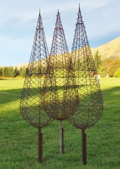 garden sculpture wire trees - I would love to see flowering vines growing on these beautiful sculptured trees. #gardensculptures