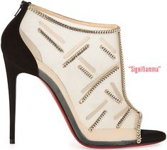 Signifiamma  nude sheer mesh peep-toe bootie with black suede detailing and silver chain embellishment; available at  Neiman Marcus