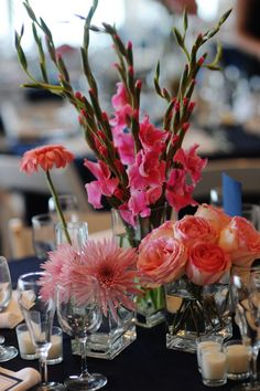 pink wedding centerpiece with different vases and types of flowers