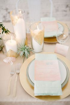 Gold and blush pink table setting with glittery candle holder centerpieces