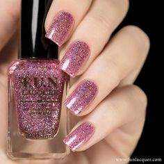 Paint your Spring nails with this pretty light pink holographic nail polish along with magenta and purple glitter and silver flakes. Collection: Spring 2016