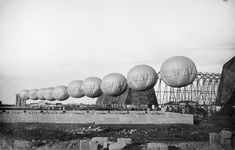 Jan 1, 1918: Row of barrage balloons used to suspend aerial nets in Brindisi, Italy.