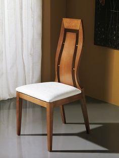 Preciosa mesa redonda para comedor tapa de color nogal y for Sillas comedor estampadas