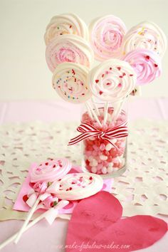 This is such a fabulous idea! Swirled meringues on sticks, a perfect alternative to over-used cake pops!