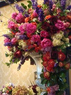 Huge floral arrangement - fuschia, purple, green