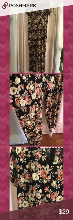 """""""Flower Power Hour"""" NWT JUMPSUIT Pretty flower print in shades of rose, khaki and cream on a black background!! Excellent pantsuit for work and play. Zips up the back. Waist is 15 inches across. Inseam is 27 inches. Width of pant leg opening is 9 across. Under arm to under arm is 18 inches across. Has label tag but no price tag. Glamorous Other"""