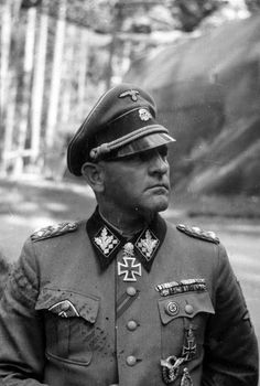 AKA BUTCHER The commander of the 1st SS Panzer Corps and SS-Oberst-Gruppenführer SS Colonel-General of the Waffen SS Panzer Sepp Dietrich (Josef Dietrich, 1892-1966) after awarding Diamonds to the Knight's Cross with Oak Leaves and Swords in Rustenburg.