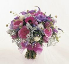Hot pink peonies with purple lisianthus and dusty miller in this hand tied bouquet. Description from flower-arrangement-advisor.com. I searched for this on bing.com/images