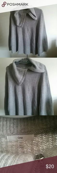 Poncho in Grey Knit with Sleeve Buttons Asymmetrical zip, this poncho is light but warm. There are inside buttons that form sorta sleeves. I bought this just last year but it deserves more wear. Size M/L. GAP Jackets & Coats