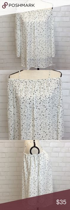 """2 day clean out!  Pleione Open ShouldersTop Super sweet off shoulder top with flowing sleeves.  Top has a very pretty white and black pattern . Size Medium Measurements: Top to bottom hem 22"""" Sleeves approximately 18.5"""" 100% Polyester Pleione Tops Blouses"""