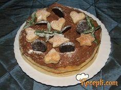 Recept za Čokoladnu tortu sa lisnatim testom. Za spremanje poslastice neophodno je pripremiti lisnato testo, slatku pavlaku, čokoladu, mentu, šećer u prahu.