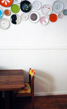 kitchen wall.  What a cute idea with collecting cute plates.  Sucks in CA that we have earthquakes... they'd have to be pretty secure or plastic. :)