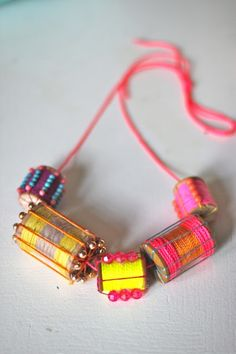 Little Pincushion Studio made this snazzy necklace out of old wooden spools!