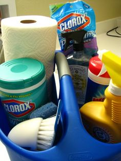 Great house warming gift   In her bathroom-cleaning kit:   A cleaning bucket  Her own rubber gloves  Scrubbing brush  Sponge  Paper towels  Cleaning supplies we use in the bathrooms