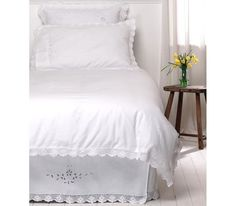 """Sasha"" is a 100% cotton duvet cover with crocheted lace trim"