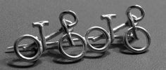 Two road bikes ride slipstream on this sturdy sterling silver handmade pin. A very versatile design allows you to express your passion for riding almost anywhere. Attach this pin to your ski hat, lapel, sweater, ball cap, tie (if you have to wear one), jacket, or almost anything else! These pins make a great gift for your favorite girl or guy rider! This original, unique and sturdy design can be worn on a jacket, sweater, hat, tie, or almost anything else! This pin is approximately 1 3/4…