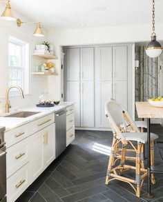 White grey brass kitchen with herringbone tile floor Flooring- MS International Slate Home Depot