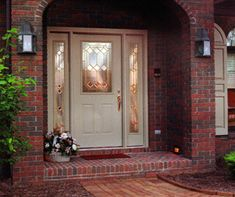 Wouldn't you love to come home to this look?  The art glass and brass hardware on this tan entry door with matching sidelights creates a beautiful look for this brick home.  We can create a beautiful impression for your Minneapolis home with an #EntryDoor like this from #ProVia.  http://www.replacementwindowsmpls.com/