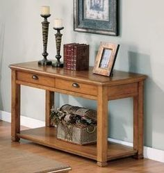 Woodside Sofa Table - 701189 - Coaster Furniture by Coaster Home Furnishings. Save 28 Off!. $323.97. Living Room->Coffee and Occasional Tables->Sofa Tables. Living Room. Sofa Table with Drawer and Shelf in Oak Finish. Some assembly may be required. Please see product details.. This lovely sofa table will give your casual contemporary living room the perfect finishing touch. The rectangular table top is generously sized, so you can decorate it with your favorite accent items. Two drawe...