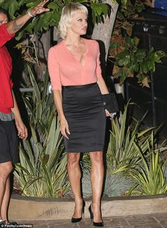 She's still got it! Pamela Anderson put her curvaceous figure on full display in a sexy fi...