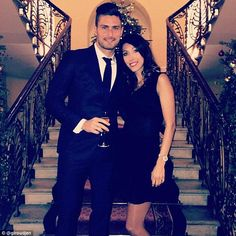 Olivier Giroud pictured with wife Jennifer as the glamorous-looking duo pose before the pa...
