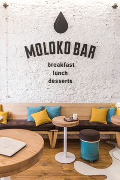 JK Lab Architects Have Designed A New Cafe In Ukraine Inside this modern cafe, a textured wall paint Deco Restaurant, Restaurant Seating, Rustic Restaurant, Cafe Seating, Rustic Cafe, Rustic Cottage, Rustic Farmhouse, Yellow Cushions, Cafe Logo