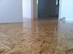 Oriented strand board as our wooden floor. With 3 layers of varnish. Osb floor / osb vloer.
