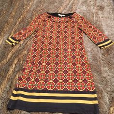 Fun dress Orange, yellow black, cute design great fit and feel. 89% polyester 11% spandex. Great pre worn condition. Aryeh Dresses