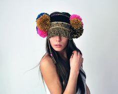 Black ethnic UTHA pom pom ear warmerheaddress by UTHAhats on Etsy, $95.00 like the colors