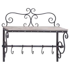 Showcasing a scrolling iron frame and wood shelf, this 5-hook wall rack is perfect for organizing towels in your powder room or outdoor accessories in the ha...