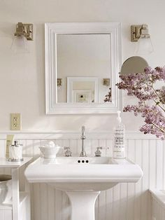 We are ripping out our huge mirror and stupid vanity in the master bathroom this winter!! Replacing them with beadboard paneling, square pedestal sinks and mirrors similar to this!!!