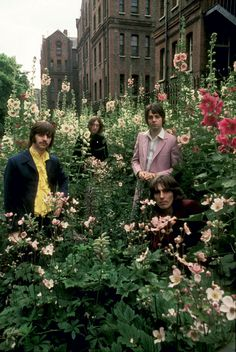 The Beatles photographed by Don McCullin at St Pancras Old Church and Gardens, London, on 28 July 1968
