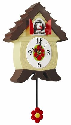 """BarkCoo Cuckoo Clock    """"Woof""""! On the hour our spotty dog pops out of the doors and welcomes all with a woof and a pant. The BarkCoo dog clock comes in a tan housing with a swinging red pendulum."""
