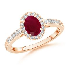 Make a statement with this Prong Set Oval Ruby Halo Ring with Diamond Accents from Angara.com. Explore a fascinating array of designs