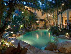 Tropical pool.  houzz.com #landscapelights #exteriorlighting