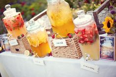 Beverage station - if I can find drink dispensers like this...Love the idea of using frozen fruit in place of ice.