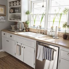 Charming country kitchen - love the open shelves filled with white china eclecticallyvintage.com