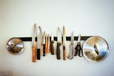 Genius Solution for Messy Pot Lid Storage: Hang Pot Lids On a Magnetic Knife Rack! I'm not sure about hanging lids but I love the idea of knives being off the counter and accessible. Kitchen Organization Guide, Pot Lid Organization, Lid Organizer, Organizing Ideas, Decluttering Ideas, Pot Lid Storage, Storage Ideas, Pan Storage, Moon Art