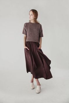 mink pullover and chocolate swingy skirt + clogs