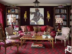 How to take risks with colour. I love the detail on the bookcases.