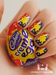 Why on earth one would have her nails done so to resemble a Cadbury creme egg? Amanzingly, I think it's quite nice, isn't it?