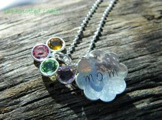 http://www.etsy.com/listing/84035708/hand-stamped-hammered-sterling-silver