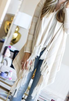 Looking for a way to incorporate the new fringe trend? How about combining it with a classic favorite - the cardigan! We're loving fringe cardigans for this season - they're super easy to layer over all of our looks! How would you sport this style?