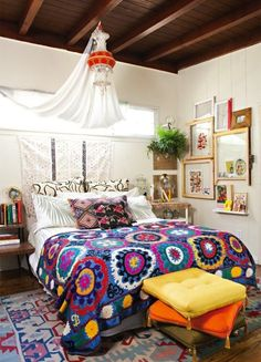 This bursting-with-color bedroom does a pro job of balancing brights with neutrals. If your walls are white, fill the room with color, or go crazy on the walls but keep the furniture and rugs on a more controlled palette.