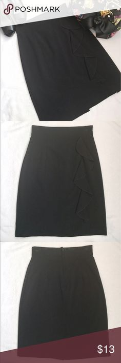 Black Pencil Skirt with Ruffle Super cute black skirt!! Ruffle down the side. Zips up back with a small slit in back. 63% polyester 33% rayon and 4% spandex. 21 in long. Waist 12 in. Hips 15 1/2. Size 3 in juniors. Excellent condition! wrapper Skirts Pencil